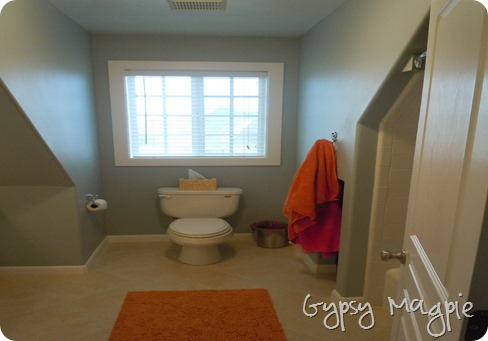 Upgrading a Boring Builder Bathroom Mirror {Gypsy Magpie}