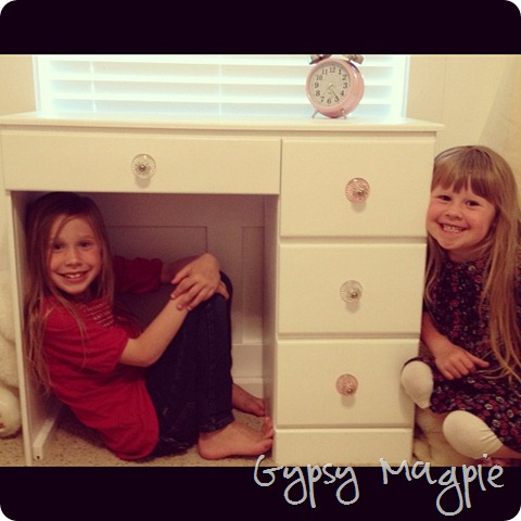 my cuties and my childhood desk with new knobs {Gypsy Magpie}