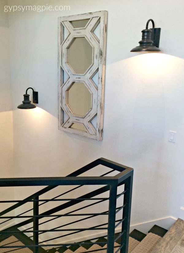 The industrial style railing in this home was really fun and the wall sconces had me drooling! Come check out more! | Gypsy Magpie