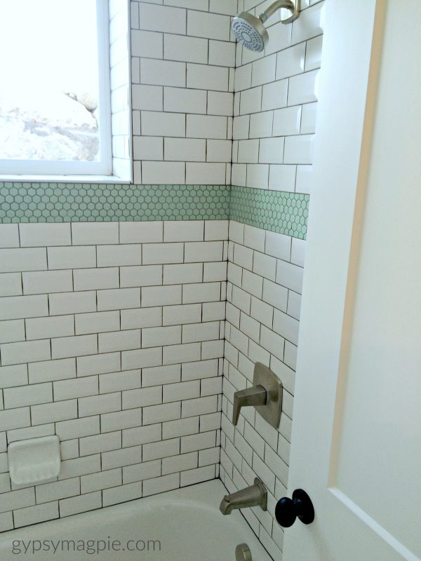 Minty green hex tiles make this subway tile pop! | Gypsy Magpie