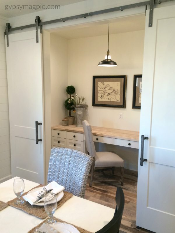 Loving this darling little nook with the rolling barn doors off the dining room! | Gypsy Magpie