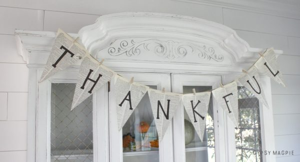 This easy and inexpensive fall pennant banner is made from book pages and is totally adaptable to all holidays! So simple! | Gypsy Magpie