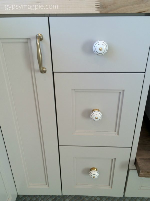Grey cabinets and brass hardware go so pretty together! Keeps things from looking cold. | Gypsy Magpie