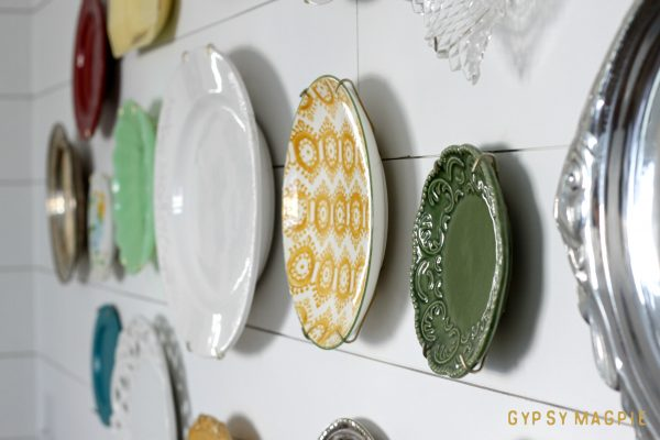 Create a pretty family history plate wall using all those special dishes gather dust in a box in the basement. The design possibilities are endless! | Gypsy Magpie