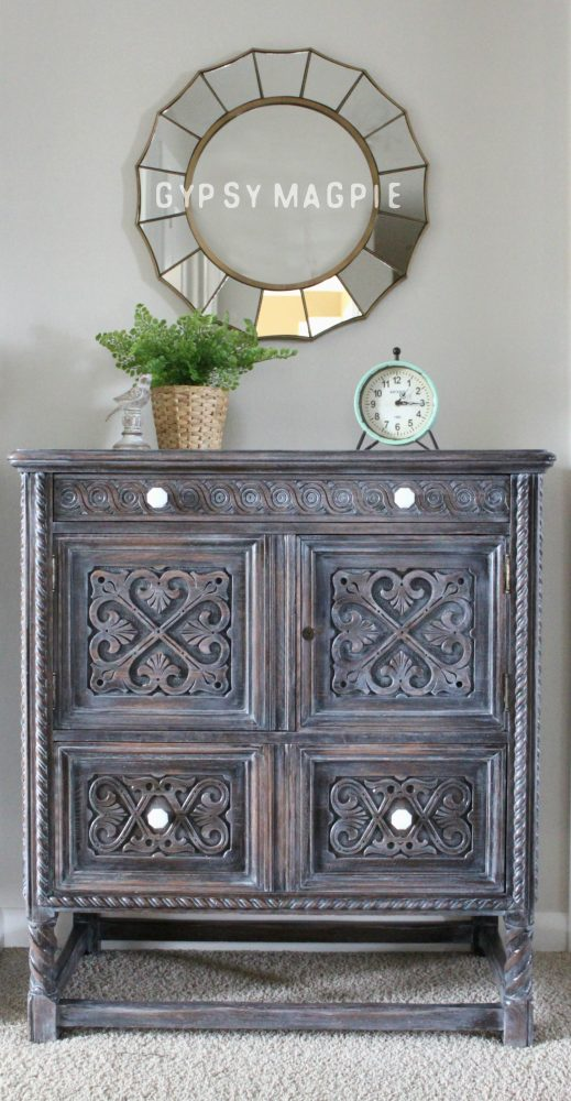 This beautiful antique cabinet was headed for the compactor at my local transfer station before it was rescued and given new life. The Winter White glaze and milk glass knobs make it shine! | Gypsy Magpie