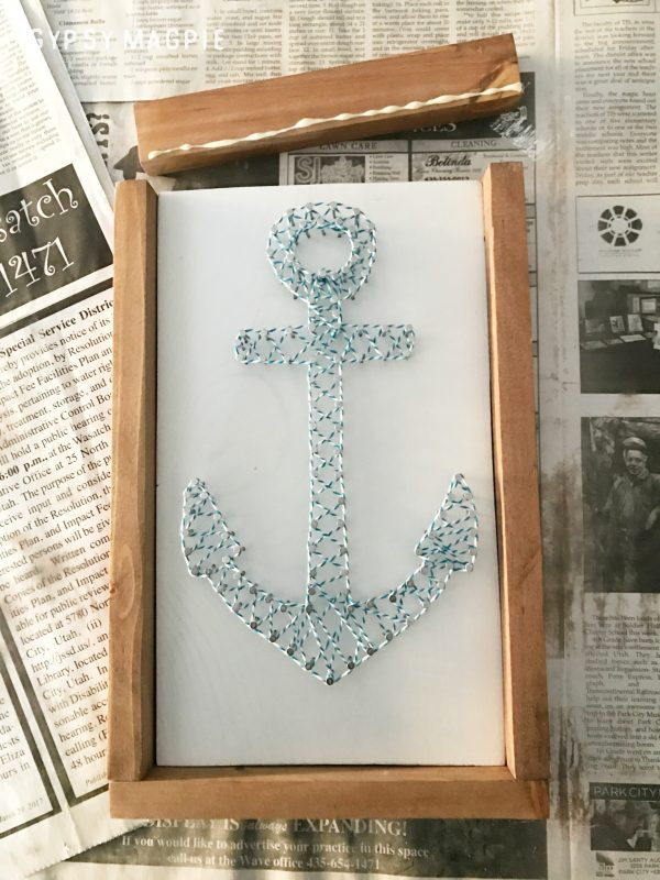 Add a small bit of glue then brad nail on the frame for your DIY string art | Gypsy Magpie