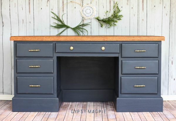 Navy blue and brass hardware give this desk a masculine feel. So fun! | Gypsy Magpie