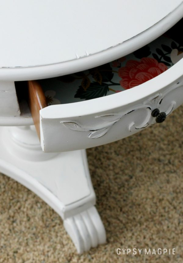 This little white pedestal table has the sweetest paper in the drawers!