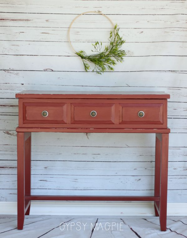 A little red paint, honeycomb paper, and new knobs gave this water stained console new life! | Gypsy Magpie