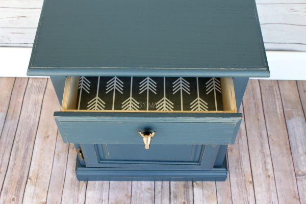 Adorable navy dresser with papered drawer and deer head knob | Gypsy Magpie