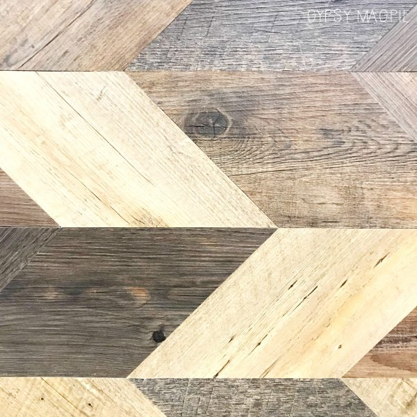 Wood set in a pattern is so trendy right now. This wood wall was definitely a statement! | Gypsy Magpie
