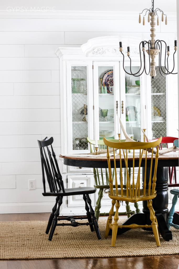 Darling dining room with shiplap walls and mismatched chairs | Gypsy Magpie