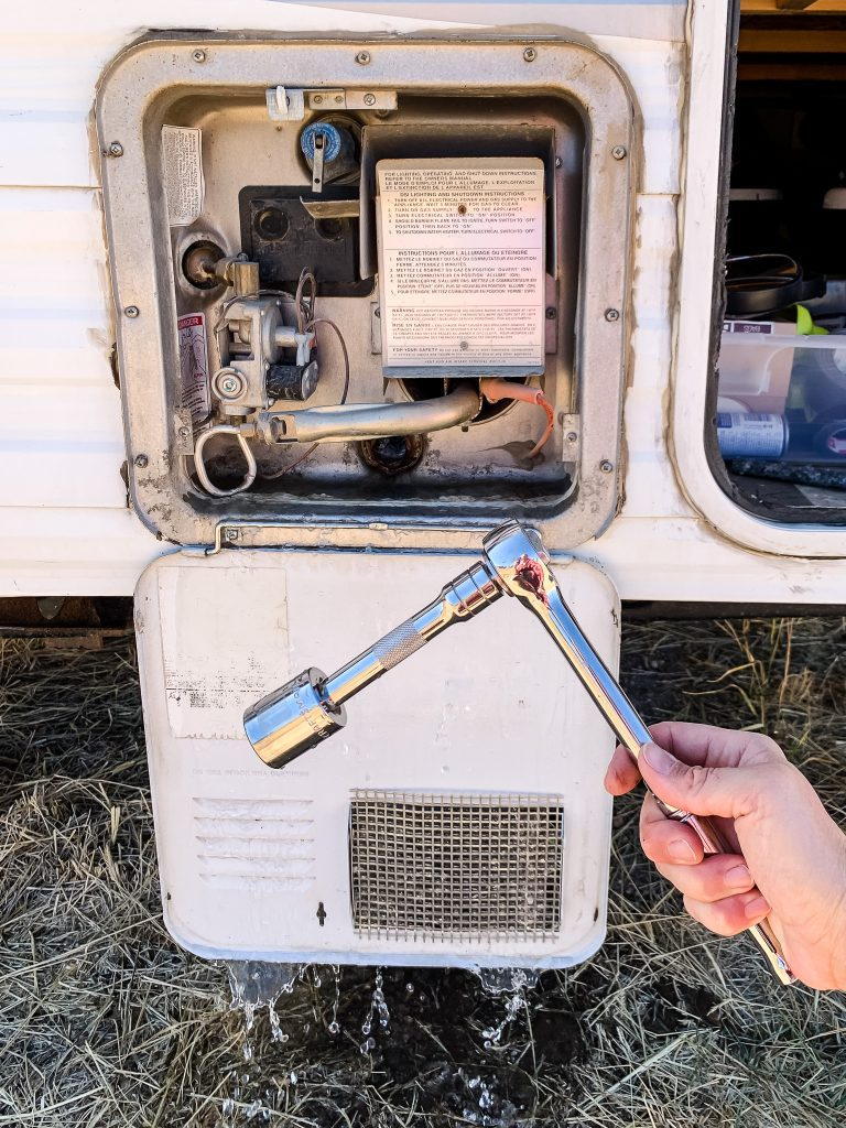 Take off the bolt of the water heater with a socket wrench | gypsy magpie