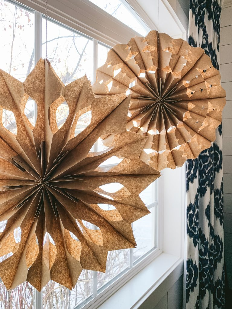 Create some magic in your windows with these simple paper sack snowflakes | gypsy magpie
