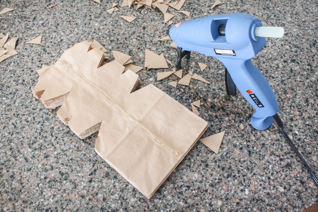 Glue guns work great to make paper sack snowflakes! | gypsy magpie
