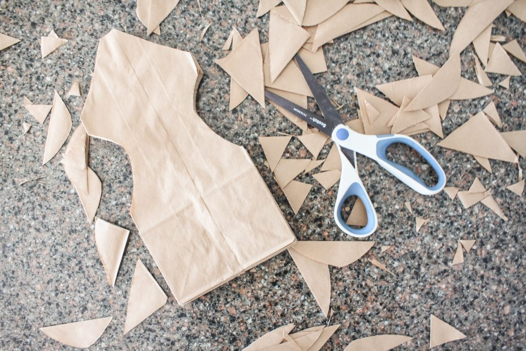 Cut designs in paper bags to make paper sack snowflakes | gypsy magpie