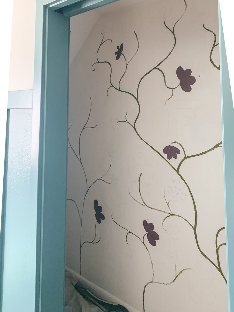 Adding the first blooms to a floral wall mural | gypsy magpie
